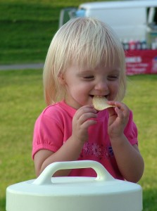child eating a potato chip